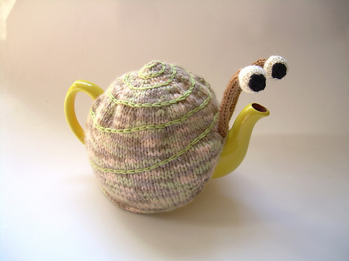 knitted snail tea cozy